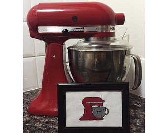 Red KitchenAid completed cross stitch in frame
