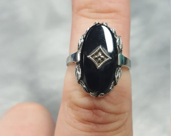 White gold and black onyx ring