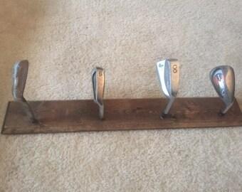 Golf club hat rack