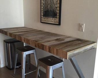 Custom made reclaim or natural wood built-in table