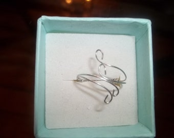 Silver wire wrapped ring.