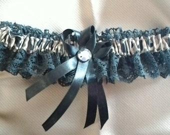 Handmade camouflage and black prom/wedding garter.