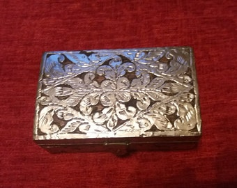 A vintage wooden boxed incased in silver tone metal