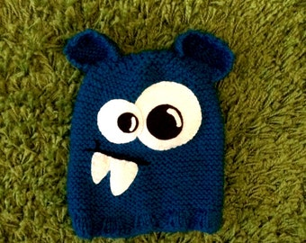 Hand knitted baby Monster hat.  Blue colour. Made to order.