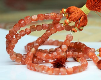 8 inch long strand faceted SUNSTONE cube beads 6 -- 7 mm