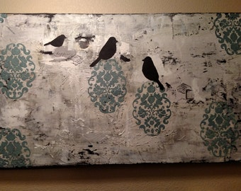 Mixed media art with birds and stencils.