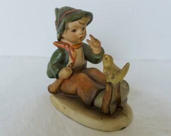 Vintage Hummel Boy with bird on foot figurine