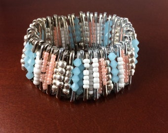 Handmade beaded stretch bracelet of safety pins and seed beads