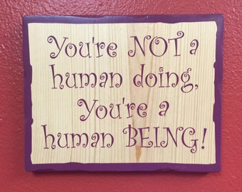 Hand painted sign - You are not a human doing, you're a human being!