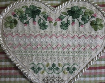 Delicate pink cross-stitched Rosebud throw pillow