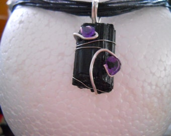 1 in black tourmaline wire wrapped with 1 heart shapped and 1 pear shapped amethyst