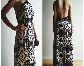 Black and white maxi dress with golden necklace