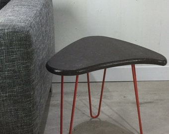 Table with top in granite and pins style Mid Century legs