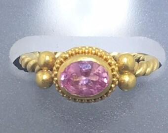 Pink gemstone and 18K gold ring