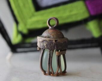 Copper and jade pendant