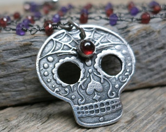 E&A Sugar Skull 2016 necklace ... recycled fine silver / original sugar skull design / red garnet / amethyst