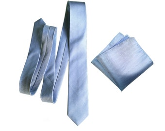 Powder blue silk necktie. Light blue, elegant woven men's tie. Pocket squares available too! Herringbone silk.