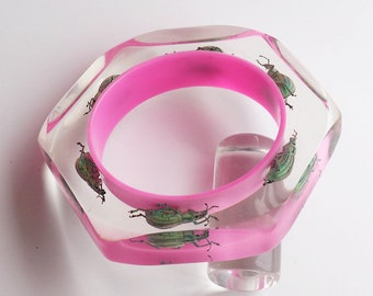 Fabulous pink faceted lucite bracelet with real metallic beetles