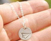 TINY PAPER AIRPLANE, circle, eco-friendly nickel free white bronze pendant. Handcrafted by Chocolate and Steel.