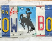 Cowboy License Plate Sign with Bucking Bronco