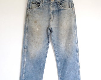 sale vintage mens destroyed blue jeans / faded grunge Wrangler work jeans / rivets distressed weathered / Made in USA / 33 waist