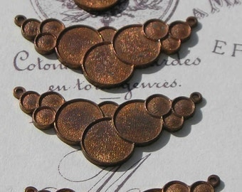 Bubbly French brass gingerbread stampings make a lovely necklace centerpiece..