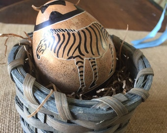 Stone Zebra Easter egg in basket