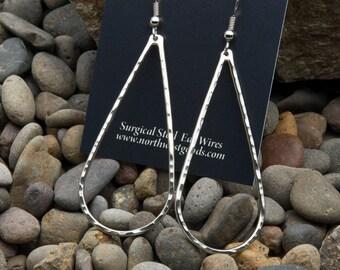 Hand pounded nickel silver teardrop dangly earrings
