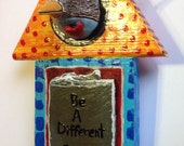 Be A Different Bird Ceramic Bird head on wood