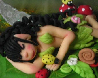 Lot's of detail Colorful Whimsical fairy made from Air dry cold porcelain