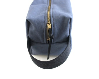 Blue grey twill toiletry bag.