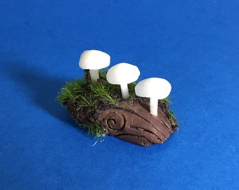 Glow-in-the-Dark White Mushrooms with Moss