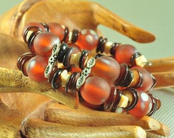 Beaded wire cuff bracelet orange matte bead with shells