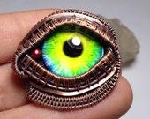 Woven wire wrapped Steampunk eye pendant