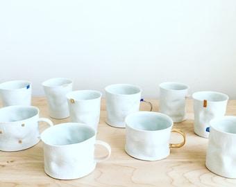 Gold handle porcelain crumple cup