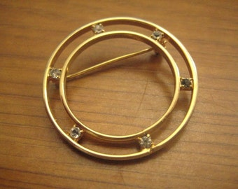 Double Circle Pin in Gold Tone Metal with Rhinestone Accents Between the Circles