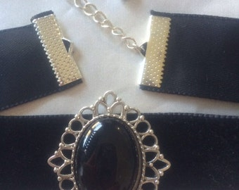 Black velvet choker with antiqued silver tone setting and black cabochon