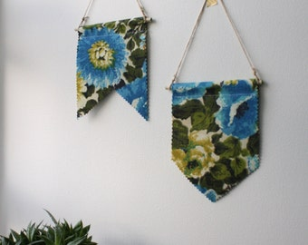 vintage. handmade fabric flag. bunting. blue and olive green floral pattern. cozy home. nursery. wall hanging.