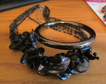 silver and black shell necklace plus