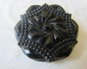 Vintage Buttons - lot of 1 large jet black, pressed floral design Victorian (lot sept 377 )