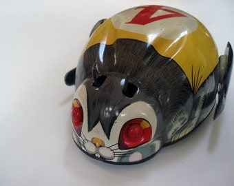 Vintage rabbit tin toy with motor and light - battery operated - Modern Toys