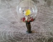 Fabulous Crystal ball with loose Tarot cards on red velvet under a Glass Bubble Dome ring