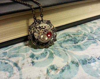 Steampunk Watch Gear Bronze Necklace with Red Stone