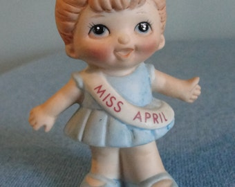 Vintage Russ porcelain Doll of the month April in a blue dress