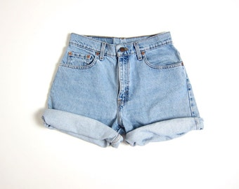 Vintage LEVIS jean shorts 90s Light Wash Blue denim shorts Grunge Shorts Womens Relaxed Fit Levis Mom Shorts Roll Up Shorts Medium