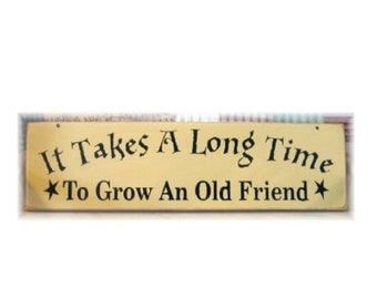 It takes a long time to grow an old friend primitive wood sign