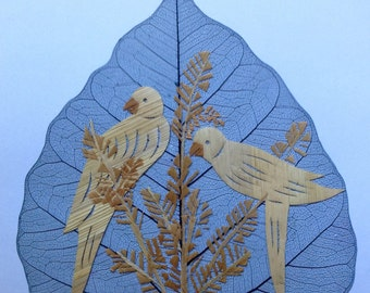 Handmade on a real leaf PARROTS with rice straw. Size 8.5 X 5.5 inches. Birds on a leaf. Unique gift, handmade,signed and numbered leaf art
