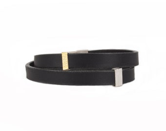 black leather bracelet with elements in silver and gold