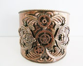 Vintage large tarnished copper steampunk style cuff bracelet with clockwork/ heart/ butterfly detail (P)