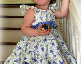 Girls ruffled dress with pettiskirt in periwinkle birthday wedding